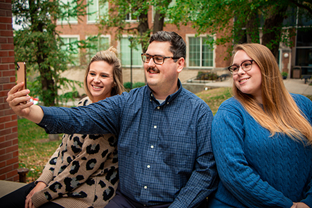 three admissions counselors