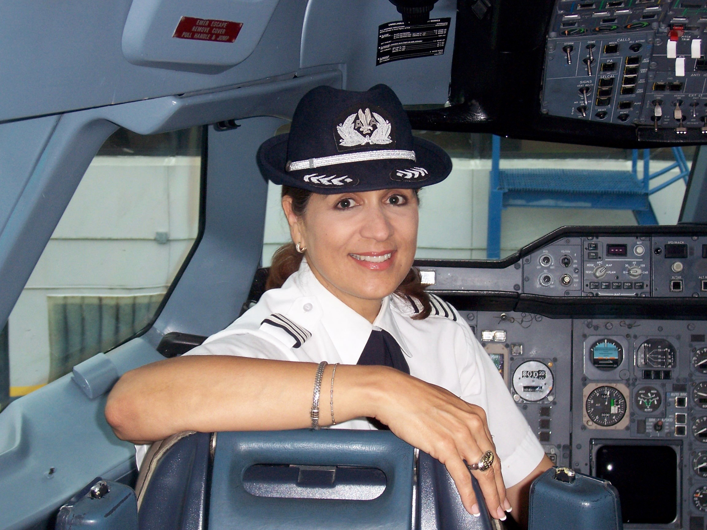 Custodio in the cockpit of an aircraft.